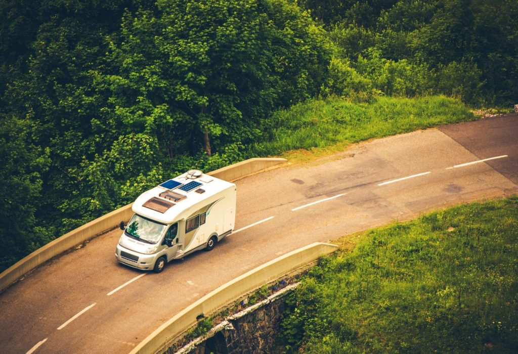 Motorhome driving on the road. Campervan Finance page featured image